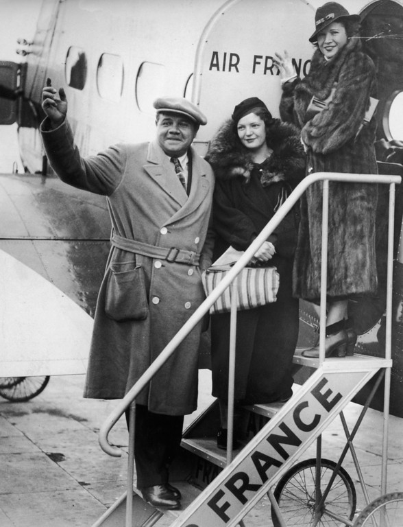 . 7th February 1935:  American baseball star, Babe Ruth (1895 - 1948) arrives at Croydon Airport near London on an Air France flight from Paris with his wife and daughter.  (Photo by Harry Todd/Fox Photos/Getty Images)