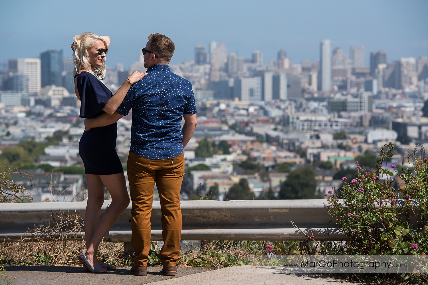 engagement session at Bernal Heights in San Francisco - cupule looking at each other with SF view