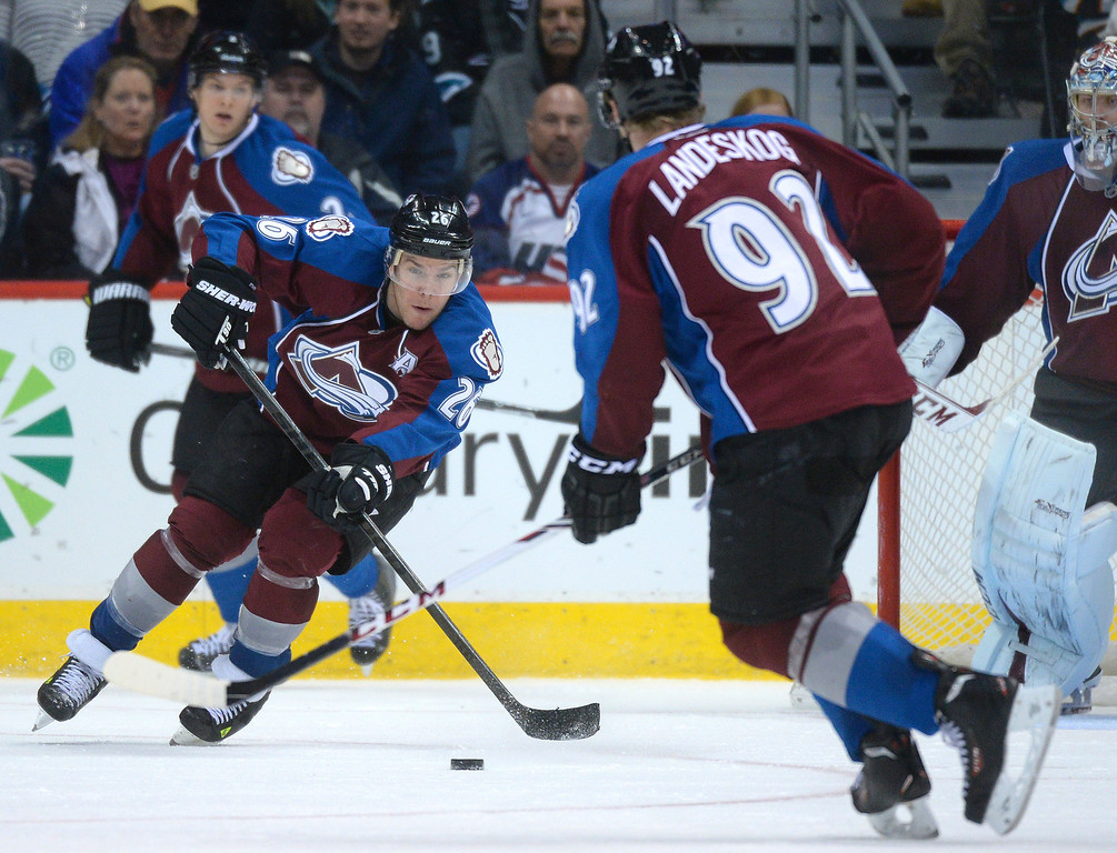 . DENVER, CO. - JANUARY 04:  Colorado center Paul Stastny (26) cleared the puck from in front of the net in the third period. The Colorado Avalanche defeated the San Jose Sharks 4-3 at the Pepsi Center Saturday afternoon, January 4, 2014. Photo By Karl Gehring/The Denver Post