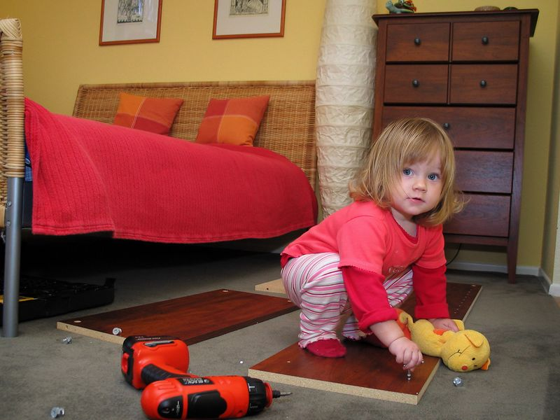 10/9 - Lili helped assembling our new bedroom furniture. She installed all the cam housings alone!