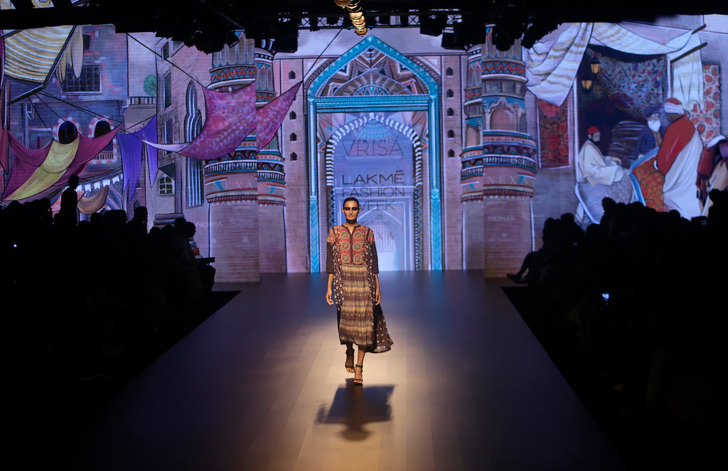 . A model walks the ramp to showcase the creation of Rahul and Shikha during the Lakme fashion week winter in Mumbai, India, Wednesday, Aug. 22, 2018. (AP Photo/Rajanish Kakade)
