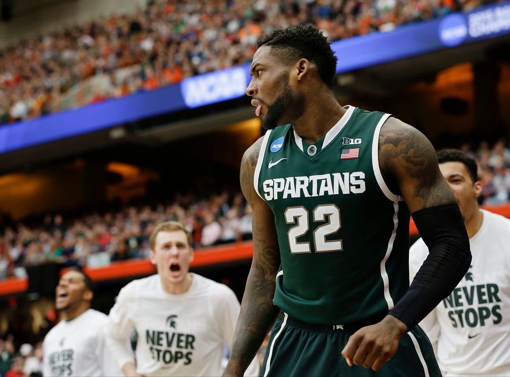 . Michigan State\'s Branden Dawson (22) is cheered on by teammates after scoring during the second half of a regional final against Louisville in the NCAA men\'s college basketball tournament Sunday, March 29, 2015, in Syracuse, N.Y. (AP Photo/Seth Wenig)