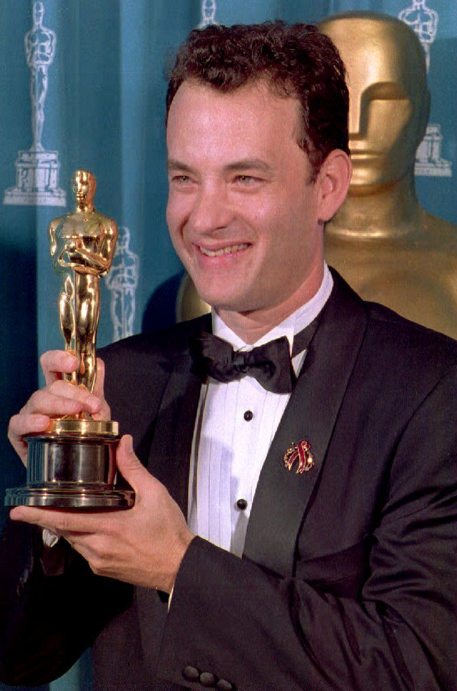 ". US actor Tom Hanks poses with his Oscar 21 March during the 66th Annual Academy Awards ceremony after winning the 1993 award for best actor for his performance in the movie ""Philadelphia.\"" TIMOTHY CLARY/AFP/Getty Images"