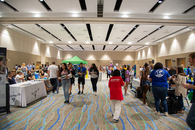 Islander students explore the Aloha Org fest in the UC anchor ballroom.