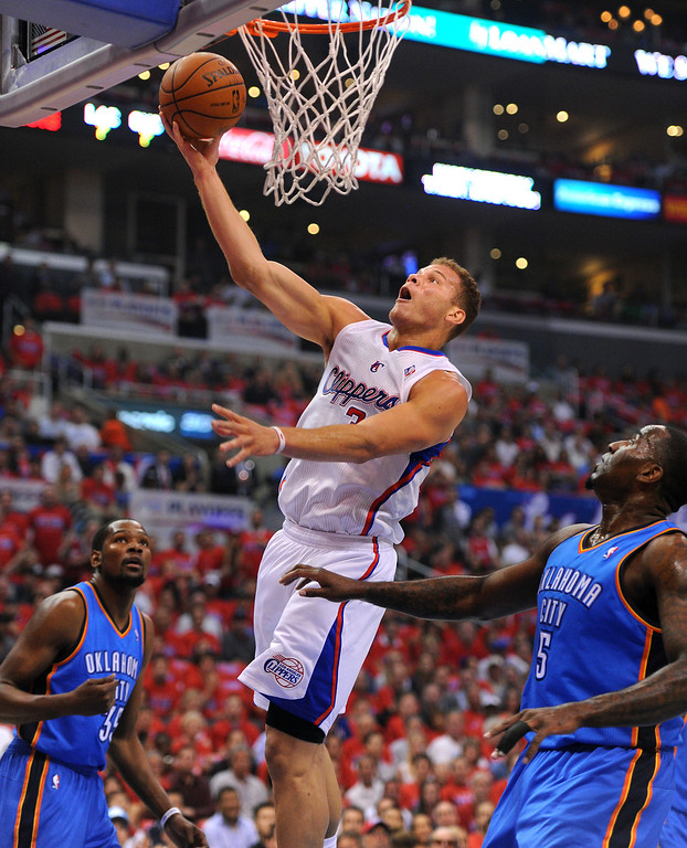 . The Clippers\' Blake Griffin goes to the basket between the Thunders\' Kevin Durant, left, and Kendrick Perkins in game six of the Western Conference semifinals, Thursday, May 15, 2014, at Staples Center. (Photo by Michael Owen Baker/Los Angeles Daily News)