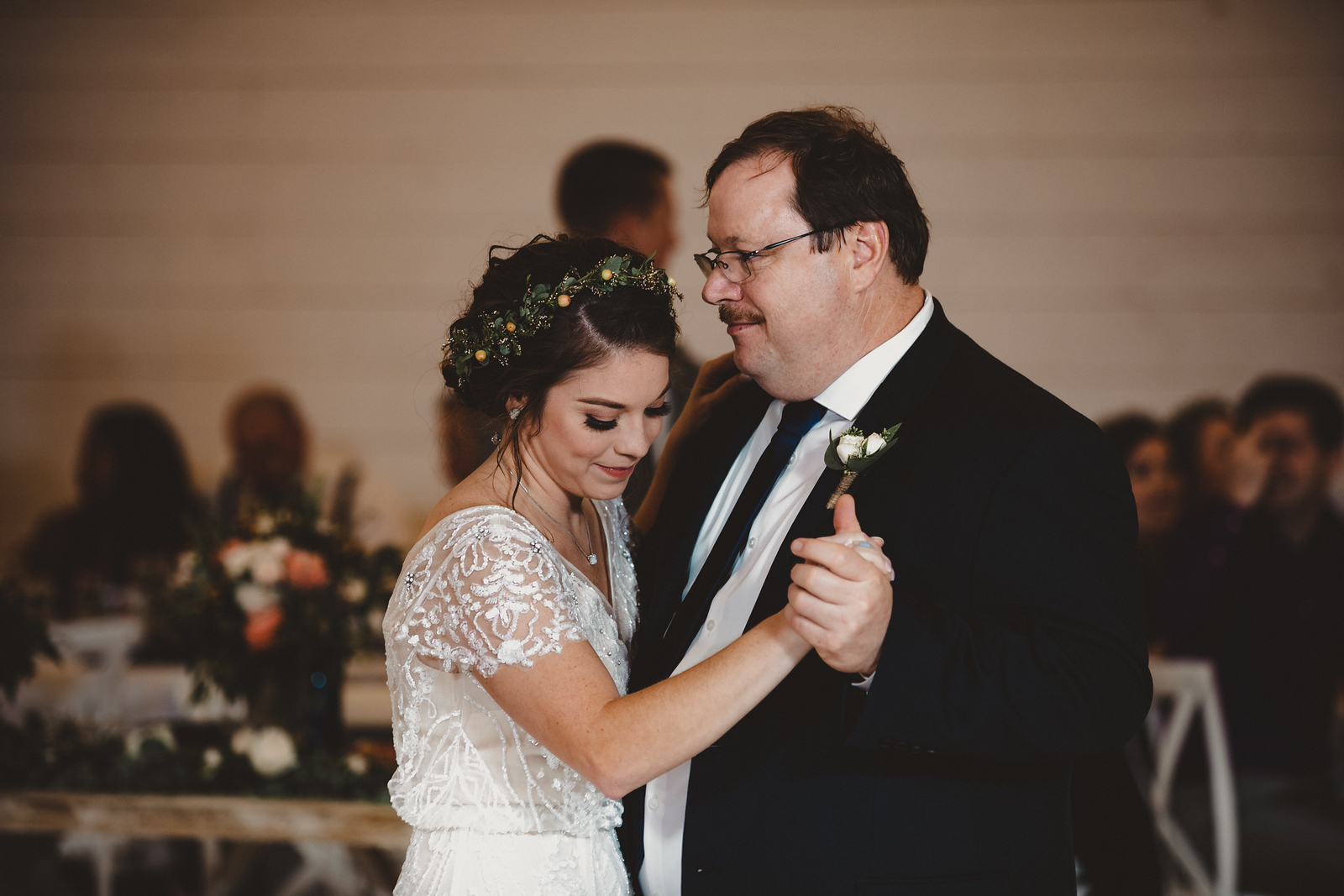 a father and bride sharing their first dance together