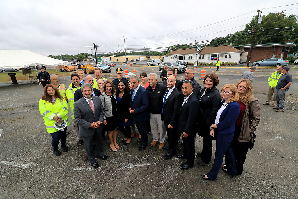 . The city\'s of Leominster and Fitchburg along with the town of Lunenburg held a ground breaking on Wednesday afternoon for the work that will be done on the 1.6 miles of road that starts in Leominster as North Street and turns into Summer Street in Lunenburg and stays Summer street in Fitchburg. Everyone posed for a picture with Summer Street in Lunenburg in the background. SENTINEL & ENTERPRISE/JOHN LOVE