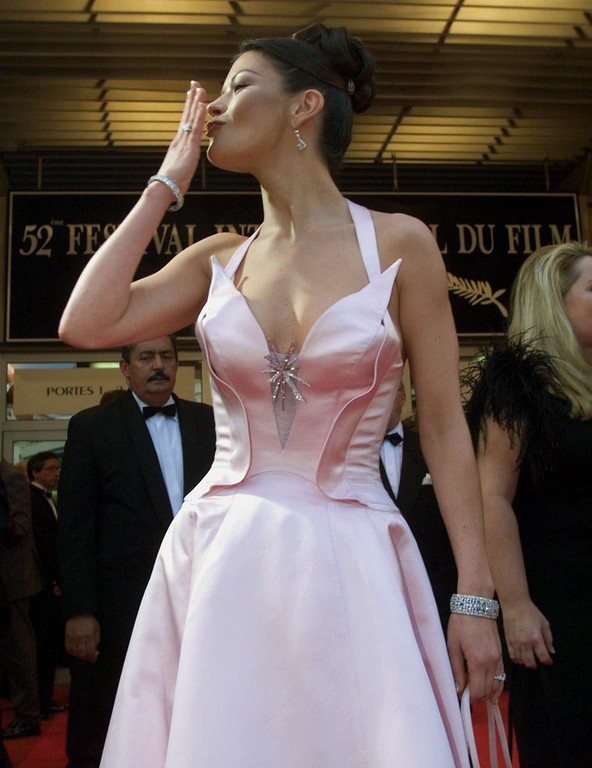 ". Welch actress Catherine Zeta-Jones blows a kiss as she arrives at the festival palace to attend the screening of her new film ""Entrapment,\"" directed by British director Jon Amiel, at the 52nd Cannes Film Festival Friday, May 14, 1999 in Cannes, France. (AP Photo/Laurent Rebours)"