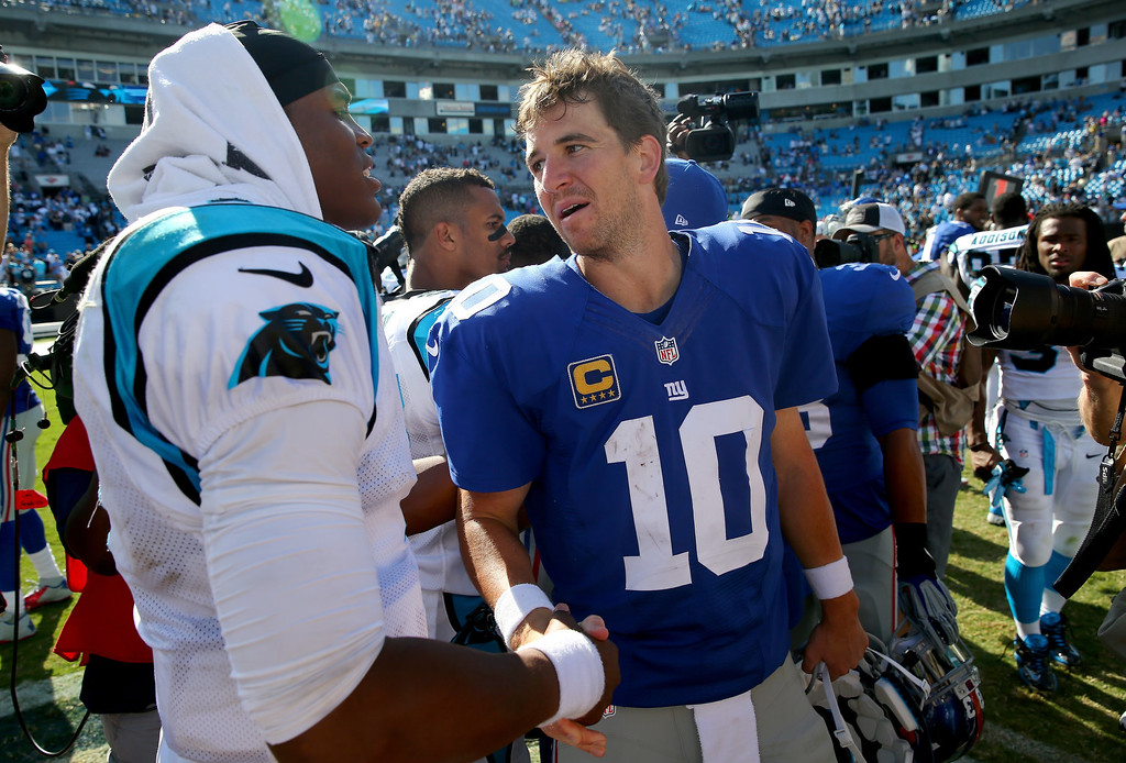 . Cam Newton #1 of the Carolina Panthers shakes hands with  Eli Manning #10 of the New York Giants after their game at Bank of America Stadium on September 22, 2013 in Charlotte, North Carolina.  (Photo by Streeter Lecka/Getty Images)