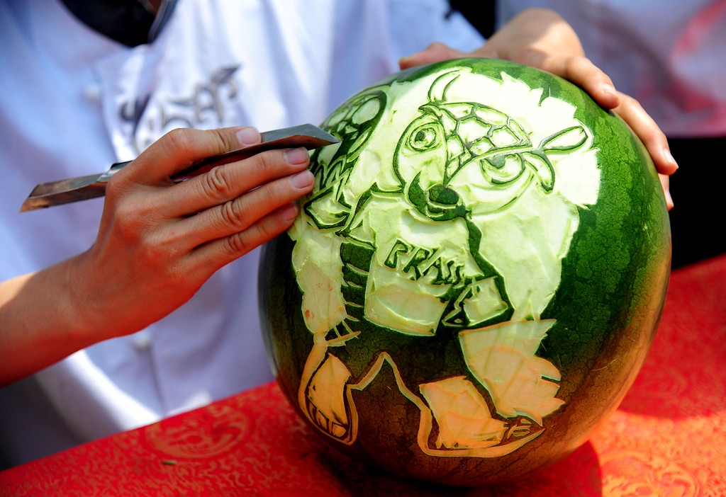 . This picture taken on June 10, 2014 shows a cook carving an image of Fuleco the Armadillo, the official mascot of the 2014 FIFA World Cup, on a watermelon in Shenyang, northeast China\'s Liaoning province. Brazil is hosting its first World Cup since 1950 from June 12 to July 13, 2014.    AFP PHOTOAFP/AFP/Getty Images