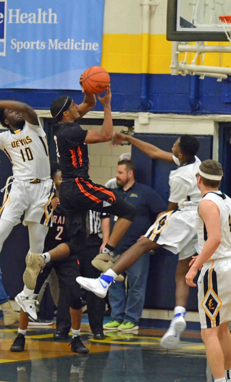. Paul DiCicco - The News-Herald Orange�s Jalen Warren drives for a basket against a tough Wickliffe defense.
