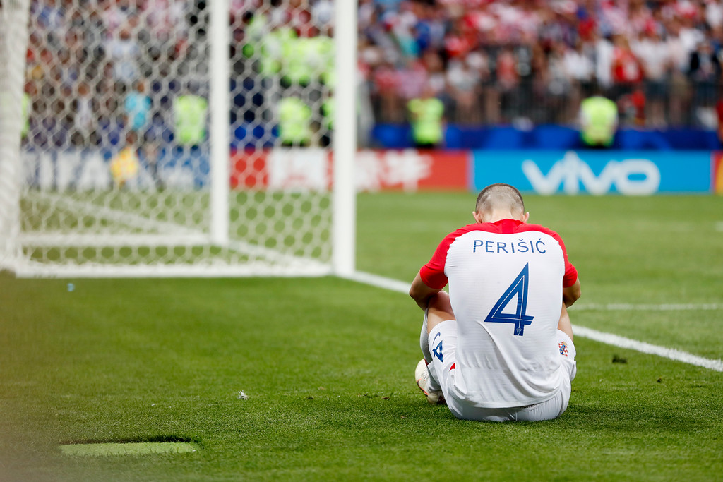 . Croatia\'s Ivan Perisic sits during the final match between France and Croatia at the 2018 soccer World Cup in the Luzhniki Stadium in Moscow, Russia, Sunday, July 15, 2018. (AP Photo/Natacha Pisarenko)