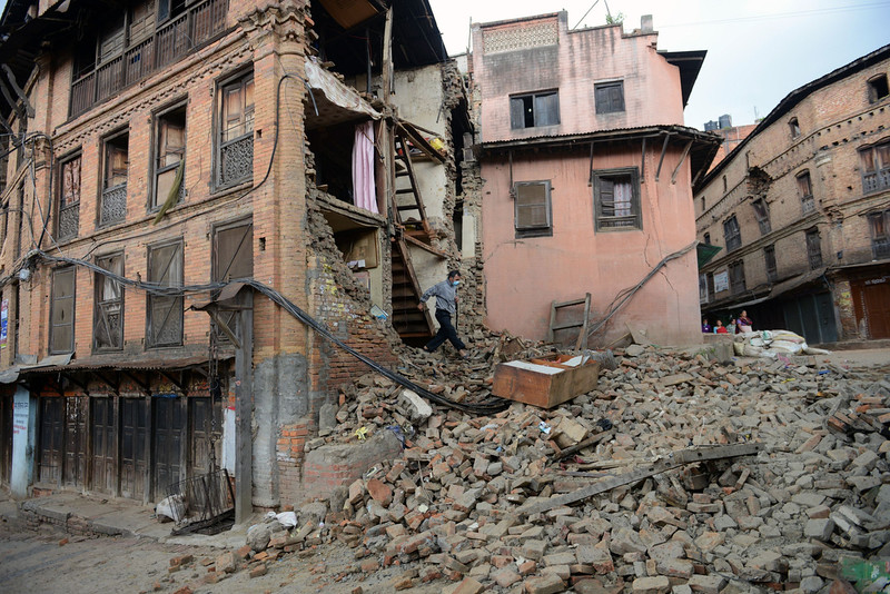 ". A man walks out of a damaged house in Bhaktapur, on the outskirts of Kathmandu, on April 27, 2015, two days after a 7.8 magnitude earthquake hit Nepal. Nepalis started fleeing their devastated capital on April 27 after an earthquake killed more than 3,800 people and toppled entire streets, as the United Nations prepared a ""massive\"" aid operation.  PRAKASH MATHEMA/AFP/Getty Images"