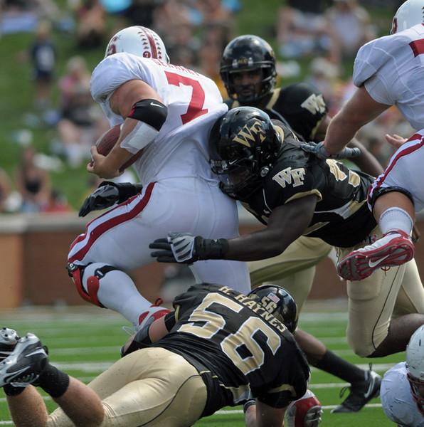 R Haynes and D Midgett tackle T Gerhart.jpg