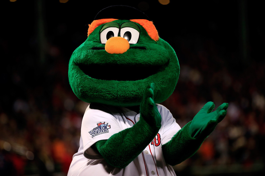 . Wally the Green Monster, mascot of the Boston Red Sox, claps before Game One of the 2013 World Series against the St. Louis Cardinals at Fenway Park on October 23, 2013 in Boston, Massachusetts.  (Photo by Jamie Squire/Getty Images)