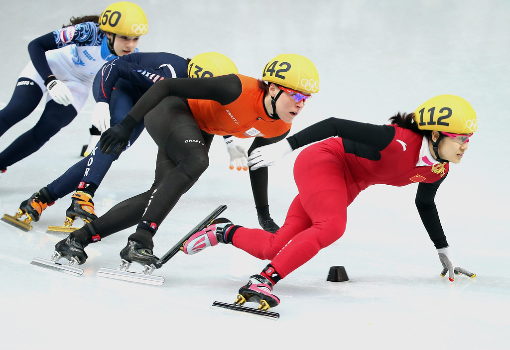 . Liu Qiuhong of China leads Kim Alang (2nd R) of Korea, Jorien ter Mors of Netherlands and Sofia Prosvirnova (L) of Russia in the women\'s 500m quarter final in the Short Track event in the Iceberg Skating Palace at the Sochi 2014 Olympic Games, Sochi, Russia, 13 February 2014.  EPA/HOW HWEE YOUNG