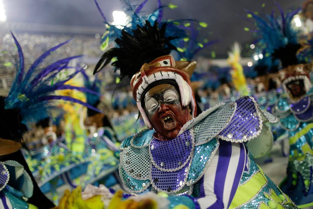 . A performer from the Academicos do Grande Rio samba school parades during Carnival celebrations at the Sambadrome in Rio de Janeiro, Brazil, Monday, Feb. 27, 2017. (AP Photo/Leo Correa)