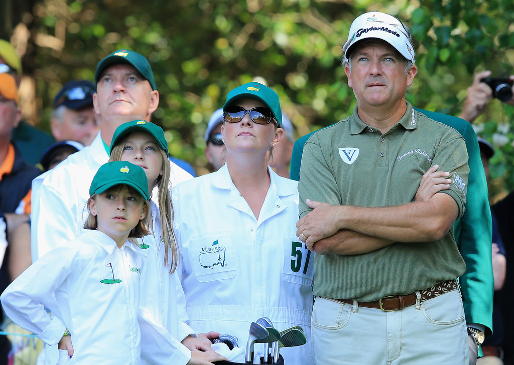 . Ken Duke of the United States waits with his family during the 2014 Par 3 Contest prior to the start of the 2014 Masters Tournament at Augusta National Golf Club on April 9, 2014 in Augusta, Georgia.  (Photo by David Cannon/Getty Images)