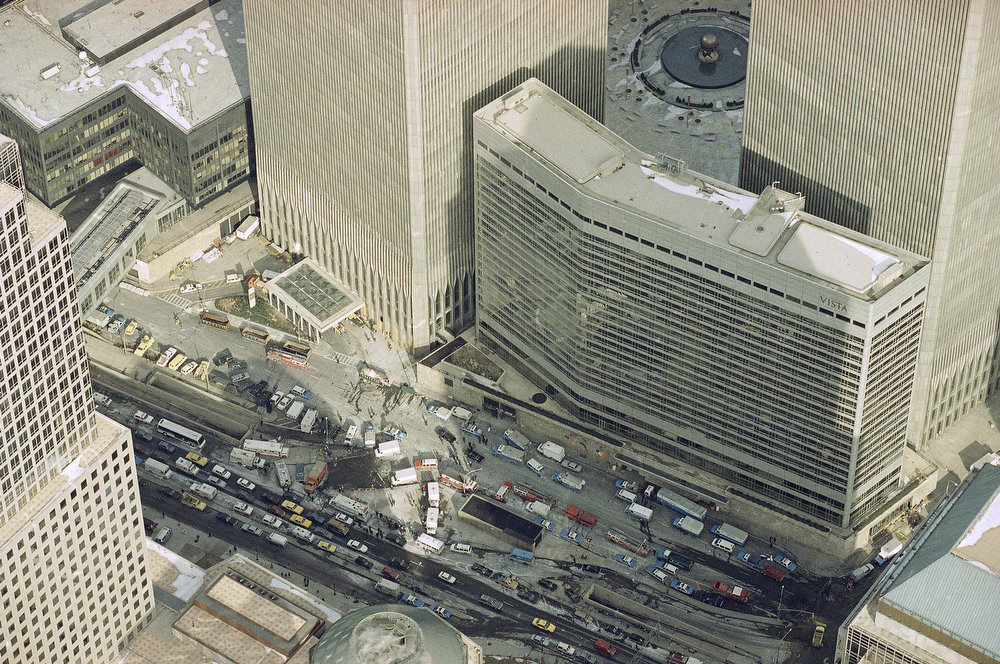 Description of . Manhattan's West Street is jammed with police and emergency service vehicles in the aftermath of yesterday's explosion that rocked New York's World Trade Center's twin towers and the Vista Hotel, foreground right, Feb. 27, 1993, causing evacuation of the financial center.  Officials all but confirmed that a bomb caused the huge blast that left at least five people dead and injured hundreds.  (AP Photo/Mike Derer)