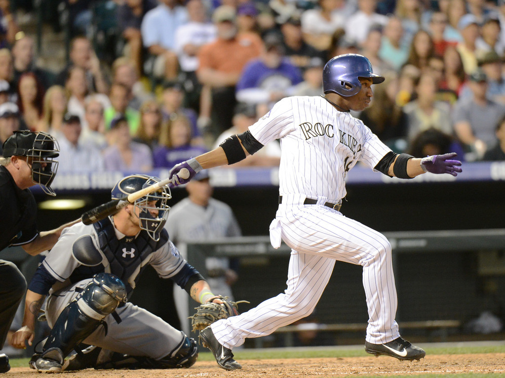 . Denver, CO. - June 08: Jonathan Herrera of Colorado Rockies (18) singles from Luke Gregerson of San Diego Padres (57) in the 9th inning of the game at Coors Field. Denver, Colorado. June 8, 2013. San Diego won 4-2. (Photo By Hyoung Chang/The Denver Post)