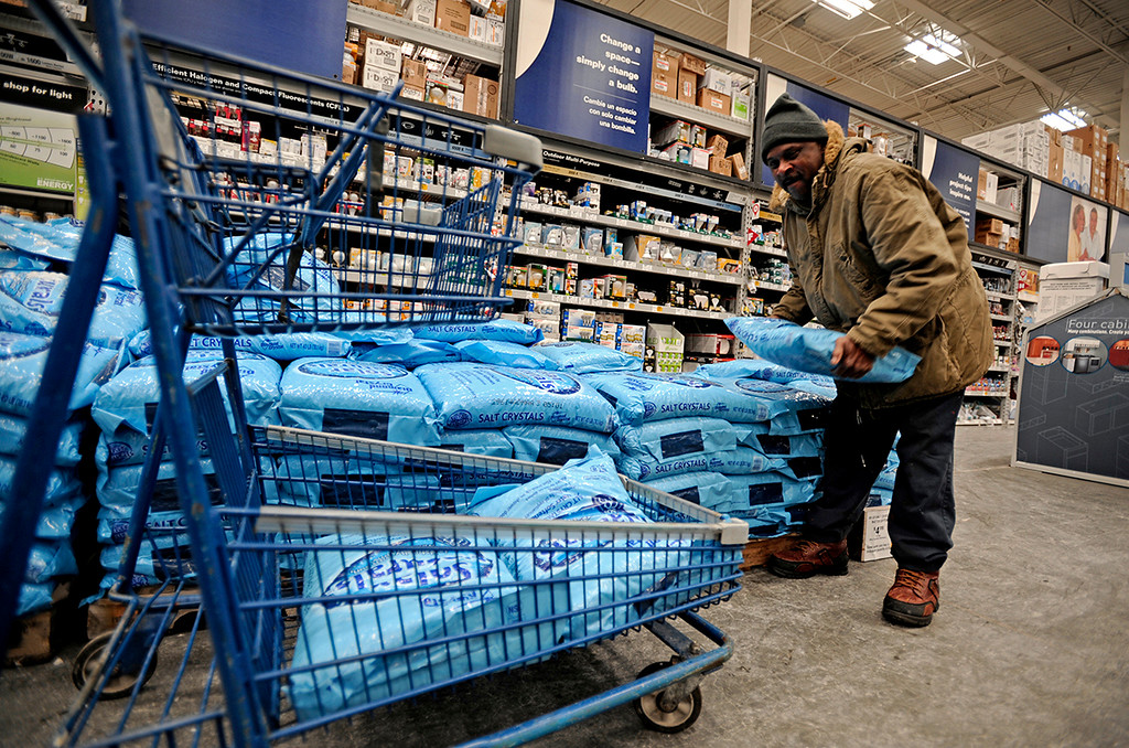 . Bobby Hall stocks up on salt pellets, at Lowe\'s in Paterson, N.J., Monday, Jan. 26, 2015. The Philadelphia-to-Boston corridor of more than 35 million people began shutting down as a monster storm, that could unload a paralyzing 1 to 3 feet of snow, moved through the northeast. (AP Photo/Northjersey.com, Amy Newman)