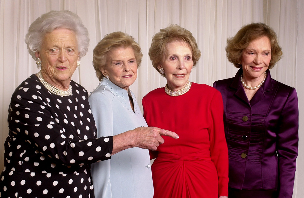 . From left, Barbara Bush helps organize a group photo of fellow former first ladies Betty Ford, Nancy Reagan and Rosalynn Carter at a gala 20th anniversary fundraising event saluting Betty Ford and the Betty Ford Center Friday, Jan. 17, 2003, in Indian Wells, Calif.  Mrs. Ford was joined by four former first ladies and two former presidents at the gala.  President and Mrs. George W.  Bush sent a videotaped tribute.  Sen. Hillary Rodham Clinton was delayed and unavailable for this photo. Some 600 guests raised $1.6 million for financial assistance for patients who cannot afford to pay for treatment.  (AP Photo/Reed Saxon)