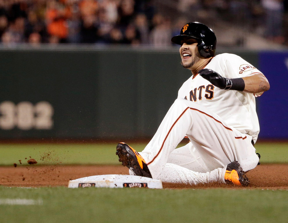 . San Francisco Giants\' Michael Morse slides into third base with a triple against the Colorado Rockies during the fourth inning of a baseball game Monday, Aug. 25, 2014, in San Francisco. (AP Photo/Marcio Jose Sanchez)
