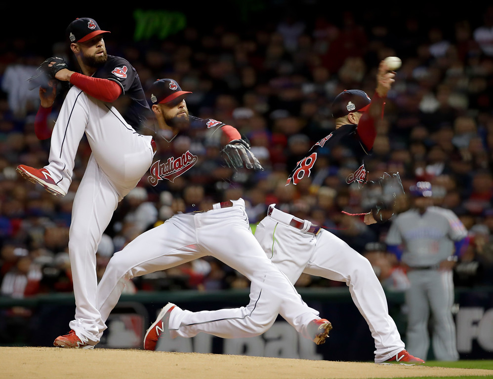 . In this multiple exposure picture, Cleveland Indians starting pitcher Corey Kluber throws against the Chicago Cubs during the third inning of Game 1 of the Major League Baseball World Series Tuesday, Oct. 25, 2016, in Cleveland. (AP Photo/Matt Slocum)