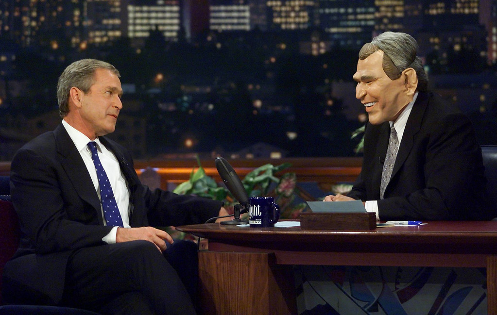 . US Republican Presidential candidate Texas Governor George W. Bush(L) looks over at Jay Leno(r) as he wears a George W. Bush mask as they clown around for upcoming Halloween  as Republican presidential candidate George W. Bush appears on the Tonight Show with Jay Leno late 30 October 2000 in Los Angeles,CA.  (PAUL J. RICHARDS/AFP/Getty Images)