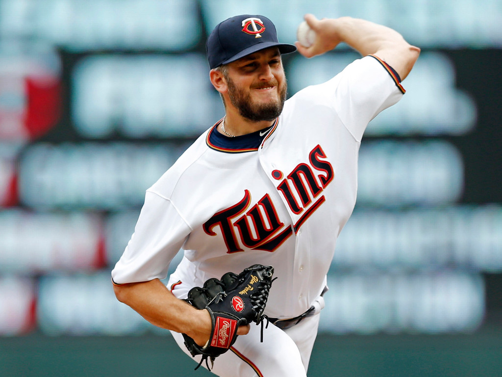 . Minnesota Twins pitcher Glen Perkins throws against the Cleveland Indians during the ninth inning in the first baseball game of a doubleheader Thursday, Aug. 17, 2017, in Minneapolis. Perkins  returned to the mound for the first time since being on the disabled list for 16 months. The Indians won 9-3.(AP Photo/Jim Mone)
