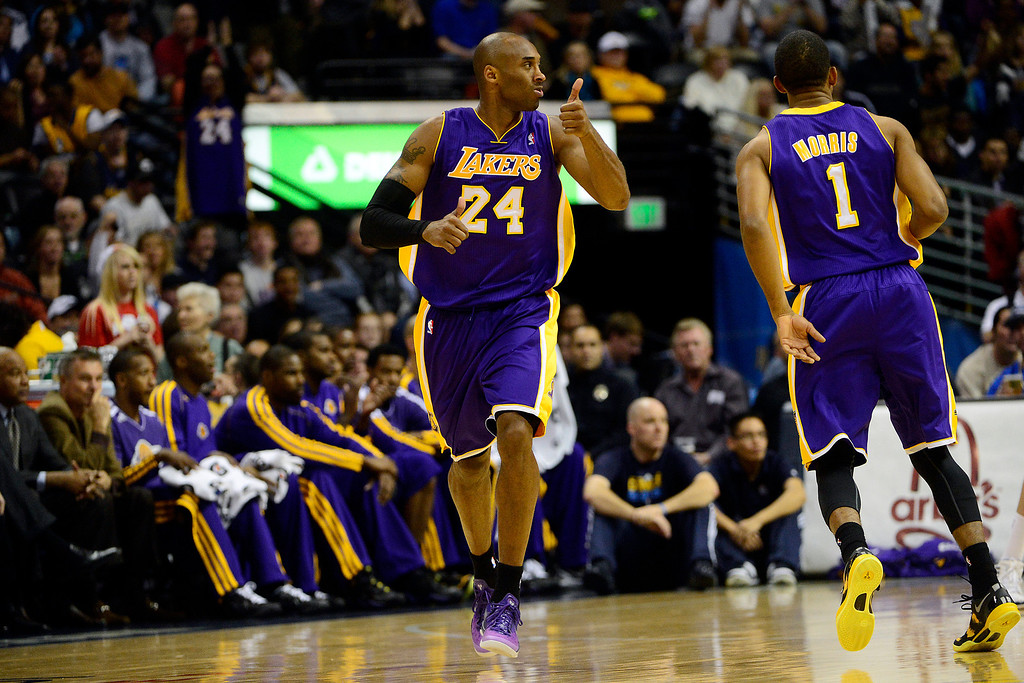 . Los Angeles Lakers shooting guard Kobe Bryant (24) gives a thumbs up to point guard Steve Nash (10) after an assist against the Denver Nuggets during the first half at the Pepsi Center on Wednesday, December 26, 2012. AAron Ontiveroz, The Denver Post