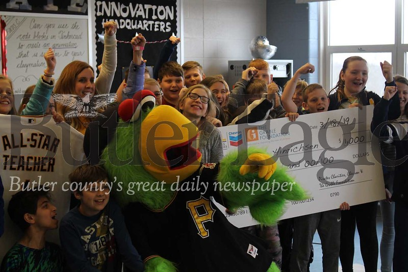 """name; representatives from Chevron, the Grable Foundation, Pittsburgh Pirates, and Pirates Charities, made a surprise visit to teacher Colleen Hinrichsen's STEAM Class to announce that she has been named an """"All Star Teacher of the Year.""""photo by Caleb Harshberger"""