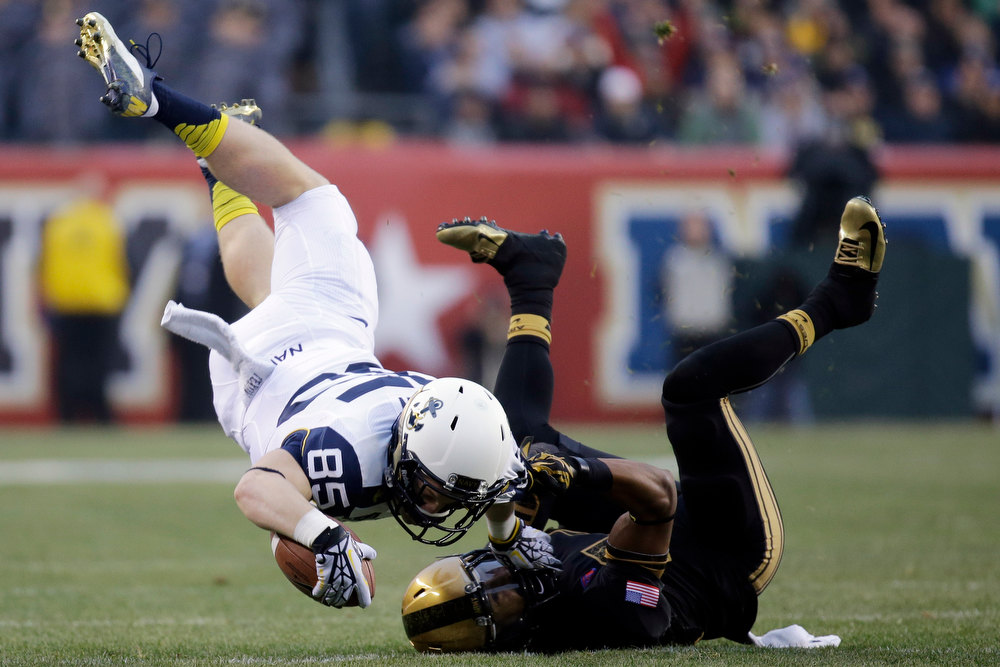 . Navy\'s Matt Aiken, left, is upended on a tackle by Army\'s Josh Jackson during the first half of an NCAA college football game, Saturday, Dec. 8, 2012, in Philadelphia. (AP Photo/Matt Slocum)