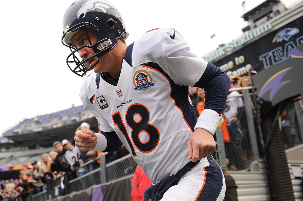 . Denver Broncos quarterback Peyton Manning #18 takes the field for their game against the Baltimore Ravens at the M&T Bank Stadium, in Baltimore , MD Sunday December 16, 2012.      Joe Amon, The Denver Post