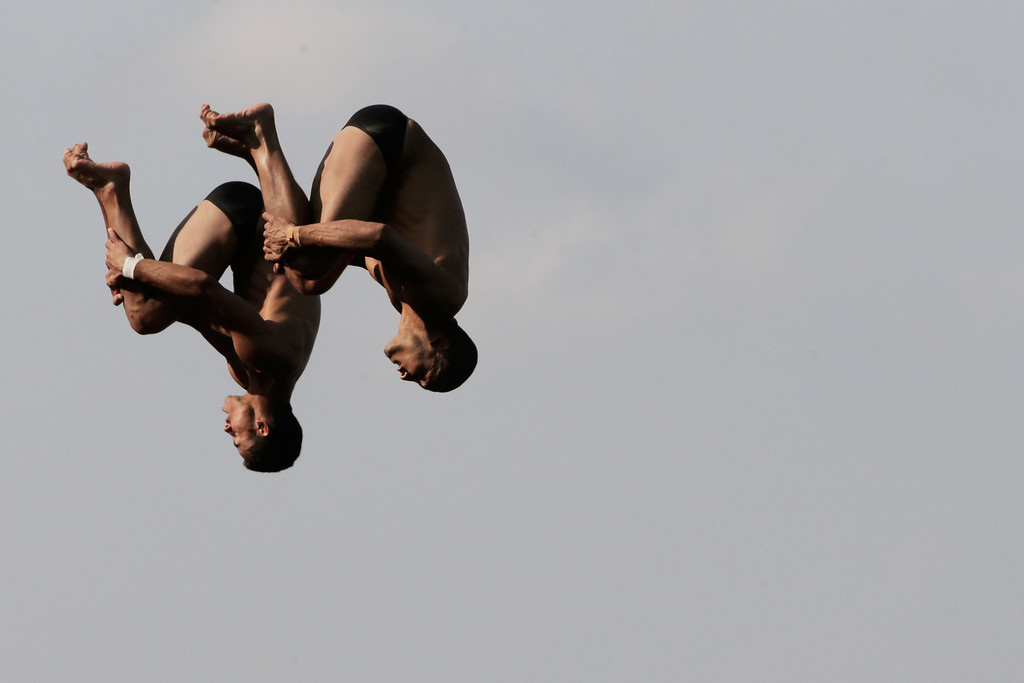 . Jose Guerra Oliva and Jeinkler Aguirre Manso of Cuba compete in the Men\'s 10m Platform Synchronised Diving final on day two of the 15th FINA World Championships at Piscina Municipal de Montjuic on July 21, 2013 in Barcelona, Spain.  (Photo by Adam Pretty/Getty Images)