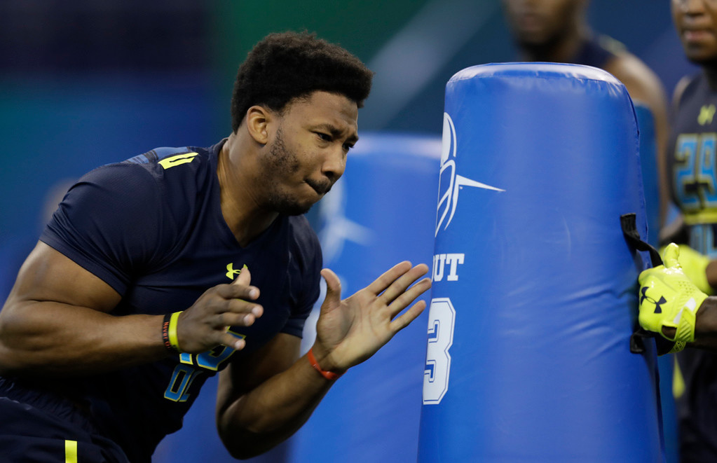 . Texas A&M defensive end Myles Garrett runs a drill at the NFL football scouting combine Sunday, March 5, 2017, in Indianapolis. (AP Photo/David J. Phillip)