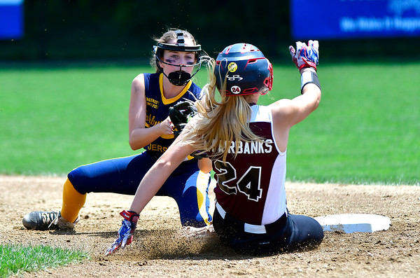 7/24/2019 Mike Orazzi | Staff New Jersey's Haley Krebs (17) as Rhode Island's Ava Fairbanks (24) steals second during Wednesday's Little League Softball game in Bristol.