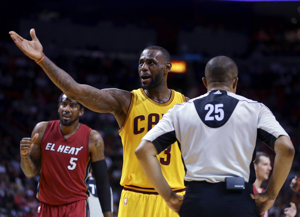 . Cleveland Cavaliers forward LeBron James (23) talks with official Tony Brothers (25) during the second half of an NBA basketball game against the Miami Heat, Saturday, March 19, 2016, in Miami. (AP Photo/Lynne Sladky)