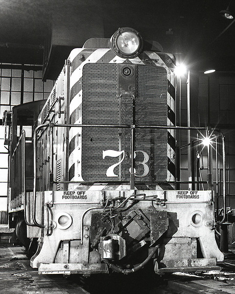 Circa. 1965.  This close-up shows the air actuated adjustable draft gear allowing the standard gauge Baldwin to switch both standard and narrow gauge cars in the Alamosa yard.