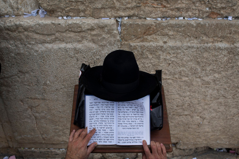 . An Ultra-orthodox Jewish man prays at the Western Wall, the holiest site where Jews can pray, in Jerusalem\'s Old City, Tuesday, April 16, 2013. Israel is celebrating its annual Independence Day, marking 65 years since the founding of the state in 1948. (AP Photo/Bernat Armangue)