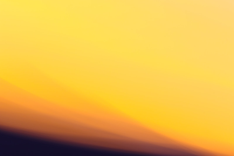 Bright and washed out yellows of a sunset in abstract