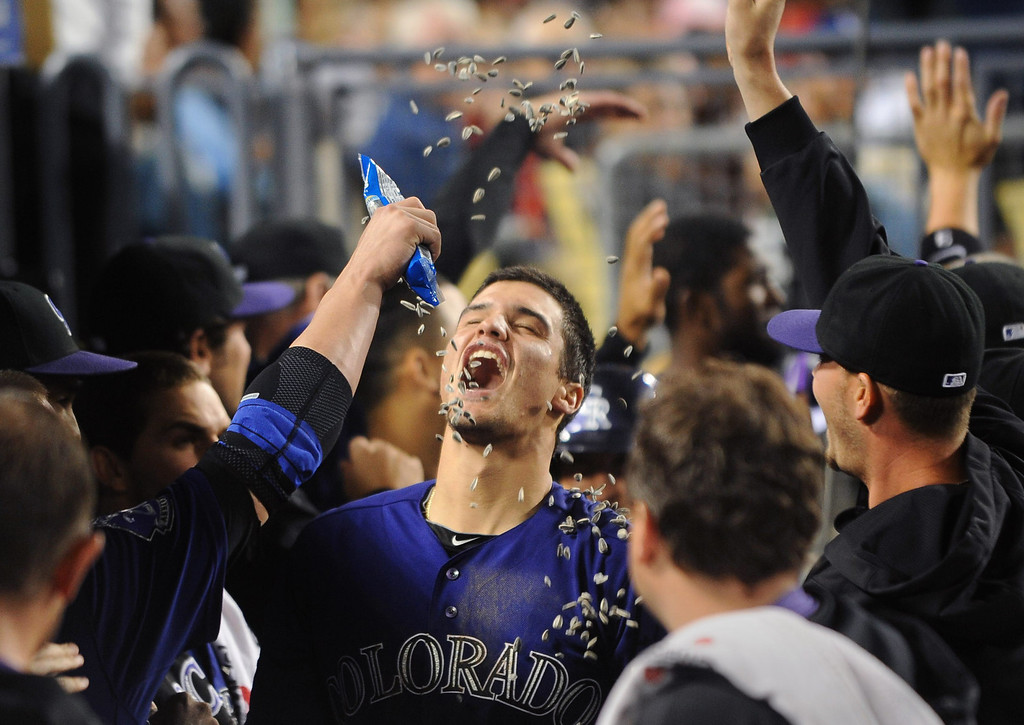 . Colorado Rockies players dump sunflower seeds on Nolan Arenado after he hit a 2-run homerun in the 5th inning against the Los Angeles Dodgers April 29, 2013 in Los Angeles, CA.(Andy Holzman/Staff Photographer)