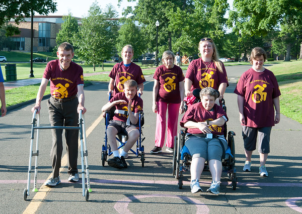 07/26/18 Wesley Bunnell | Staff The eleventh annual Walk & Roll was held Thursday evening at Walnut Hill Park hosted by the city's Commission on Persons with Disabilities. The event celebrates the signing of the American with Disabilities Act of 1980 as well as raises awareness of abilities people with disabilities still have. Members of the Oak Wood Drive house of CCARC are Jeffrey Merkel, L, Residential Service Instructor Ashlee Stimson stands behind Jacek Sudol, Mary Smedberg, Residential Service Instructor Nataljia Liberacki standing behind Patricia Packer and Stacey Dinunzio.