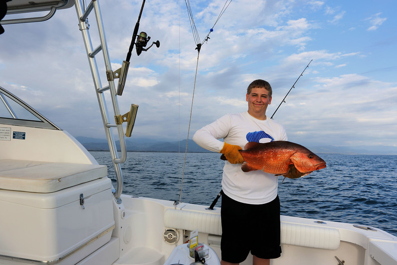 Chase with Pacific Cubera Snapper.jpg