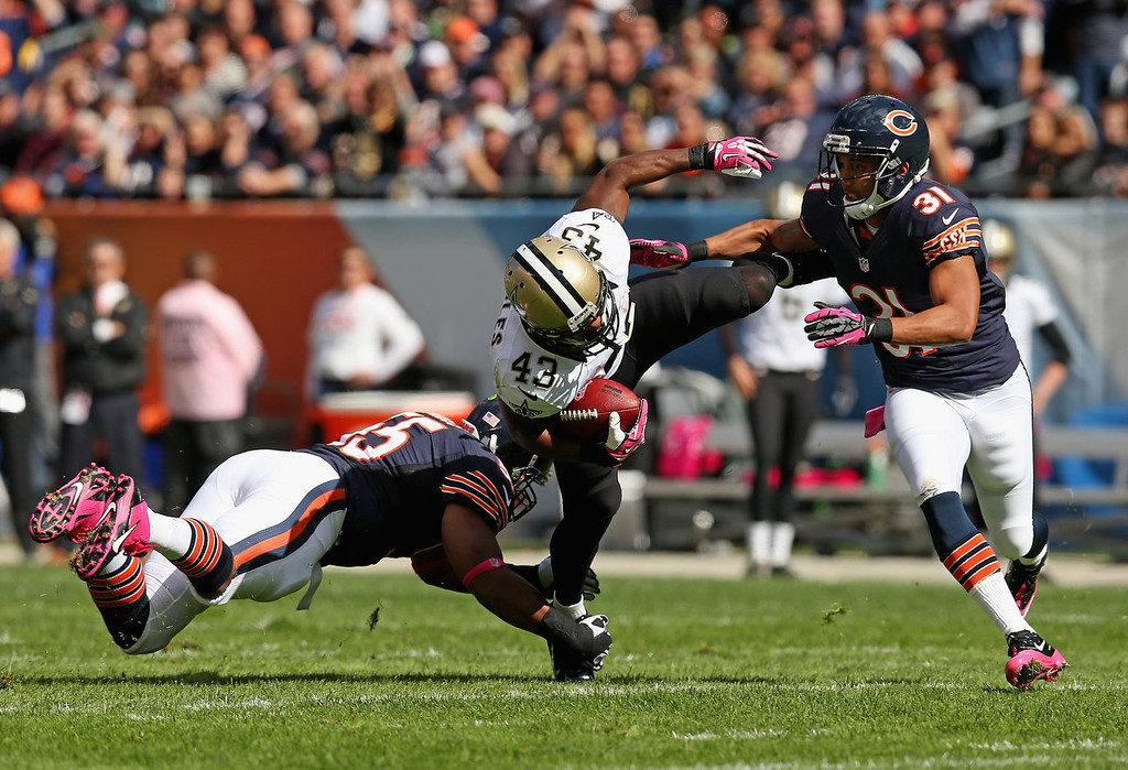 . Darren Sproles #43 of the New Orleans Saints is brought down by Lance Briggs #55 (L) and Isaiah Frey #31 of the Chicago Bears at Soldier Field on October 6, 2013 in Chicago, Illinois. The Saints defeated the Bears 26-18. (Photo by Jonathan Daniel/Getty Images)