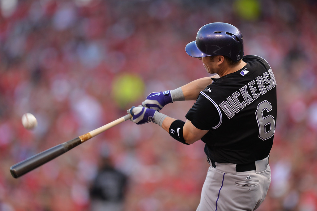 . CINCINNATI, OH - MAY 10:  Corey Dickerson #6 of the Colorado Rockies connects for a solo home run in the first inning against the Cincinnati Reds at Great American Ball Park on May 10, 2014 in Cincinnati, Ohio. Dickerson\'s home run followed a lead off home run by Charlie Blackmon #19 of the Colorado Rockies   (Photo by Jamie Sabau/Getty Images)