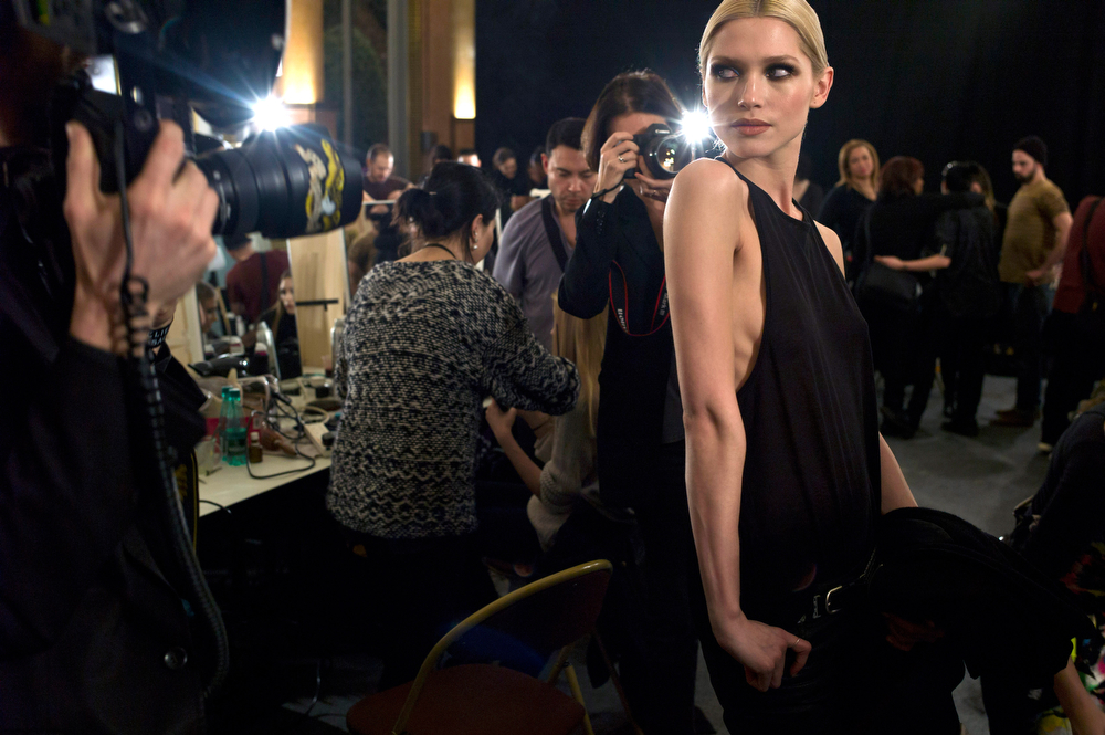 . A model poses for photographers backstage, prior to the Atelier Versace Haute Couture Spring-Summer 2014 fashion collection, presented in Paris, Sunday, Jan. 19, 2014. (AP Photo/Thibault Camus)