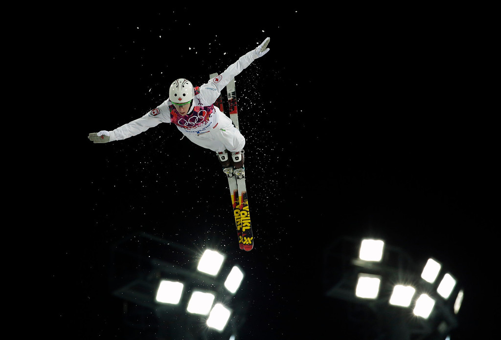 . Canada\'s Travis Gerrits jumps during the men\'s freestyle skiing aerials final at the Rosa Khutor Extreme Park, at the 2014 Winter Olympics, Monday, Feb. 17, 2014, in Krasnaya Polyana, Russia. (AP Photo/Andy Wong)