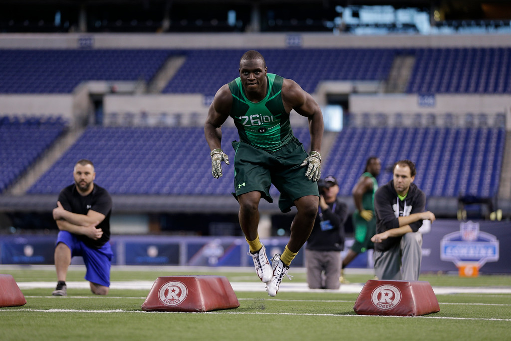 . Harvard defensive lineman Zack Hodges runs a drill at the NFL football scouting combine in Indianapolis, Sunday, Feb. 22, 2015. (AP Photo/David J. Phillip)
