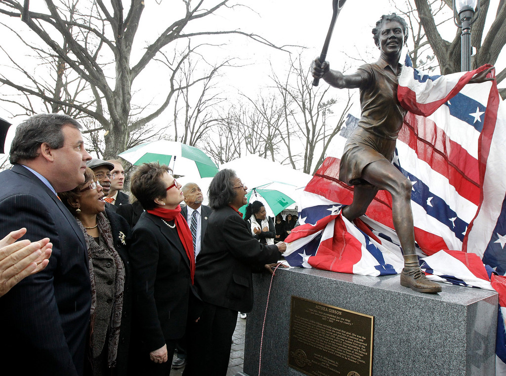 . New Jersey Gov. Chris Christie, left, and former tennis star Billie Jean King, center left, look on as a statue of tennis star Althea Gibson is revealed at Branch Brook Park, Wednesday, March 28, 2012, in Newark, N.J. (AP Photo/Julio Cortez)